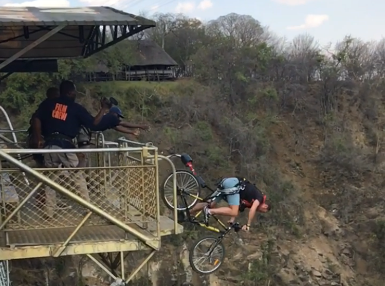 Joburg2Kili cyclists bungee jump off Victoria Falls Bridge with Qhubeka Buffalo Bicycles