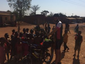 Crowds of kids gathered to check our bicycles and to chat to us before heading off for a 114km cycle
