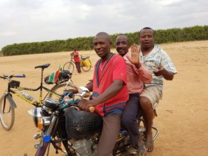 Emmanuel and his brother bringing the chief of the village to view our campsite
