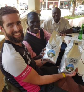 Warrick with the owner of Union Cafe Danford who kindly donated us some delicious Tanzanian Coffee Beans & Gilbert who will be the guide taking Cam, Gareth and Warrick up Mt. Kilimanjaro