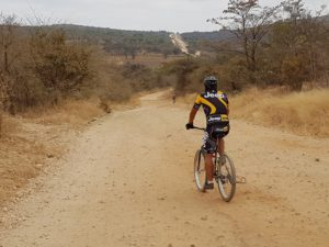 Tough riding along dirt road through a mountain pass